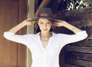 Model is wearing KBLA Slub Oxford, Fedora and Jewelry